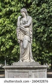 Antique sculpture in Jardin des Tuileries (Tuileries garden) - favorite spot for rest of tourists and Parisians. Garden was created by Catherine de Medici in 1564. Paris, France.