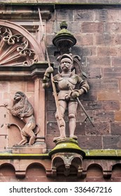 Antique sculpture of a knight and a wall fragment of castle in Heidelberg, Germany