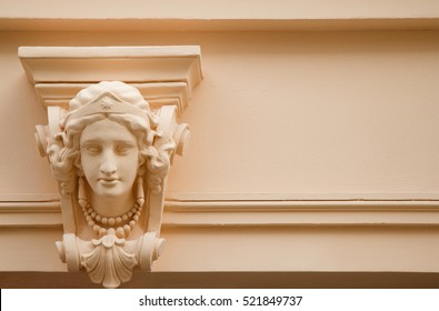 antique sculpture on wall