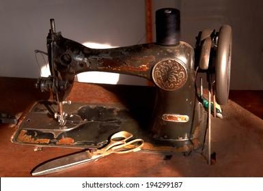 Antique sewing machine in work shop