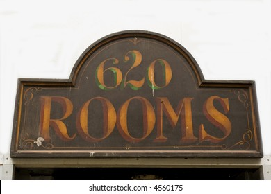 antique sign above a door on former hotel building in Vancouver downtown