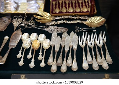 Antique silver Cutlery, spoons, forks, knives on the shelf of the flea market.