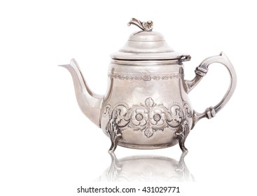Antique silver teapot isolated on white with a clipping path.