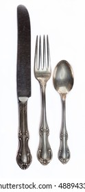 Antique Silverware on white background.