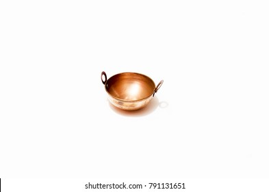 An antique small miniature version of old Indian cooking vessel made of brass metal