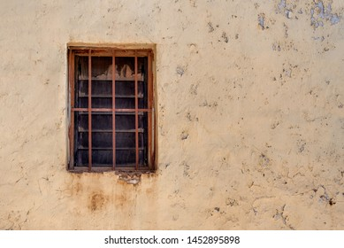 Antique solo window frame on a masonry building with paint peeling