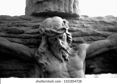 Antique statue of death and resurrection of Jesus of Nazareth.  Bible story about the crucifixion of Jesus Christ as a symbol of hope for people in eternal life.