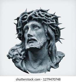 Antique statue of Jesus Christ crown of thorns against white background.