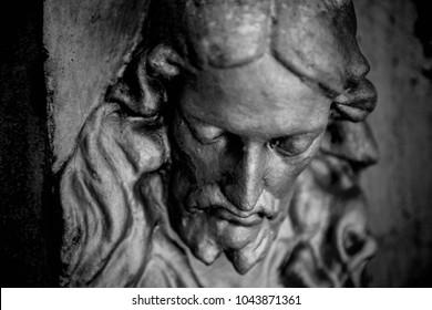 Antique statue  of suffering of Jesus Christ (religion, faith, death, resurrection, eternity concept)