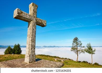 Antique stone cross sanctuary in Asturias, Spain. El Acebo viewpoint