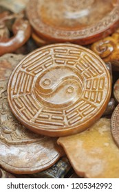 Antique stone with Yin-Yang carving on a flea market, Beijing, China.