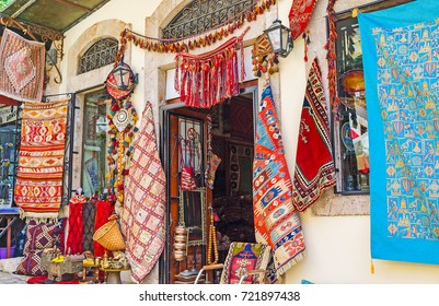 The antique store of rugs, carpets and other pieces of traditional Ottoman art, located in Old Bazaar of Antalya, Turkey.