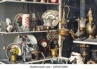Antique store window. Vintage objects in sunlight