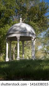 Antique style gazebo. Parkland. White gazebo in the Park.