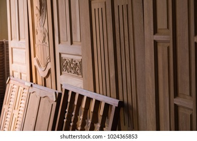 Antique style wooden furniture such as  windows, doors, fence, place on the floor in the wood warehouse.