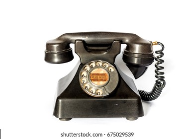 Antique telephone on a white background.