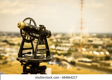 Antique Telescope overlooking a city