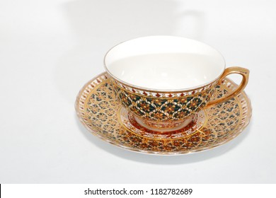 Antique thai ceramics porcelain, benjarong tea cup and saucer isolated on white background