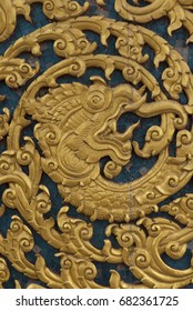 Antique Thai traditional art wood carved pattern on temple door.
