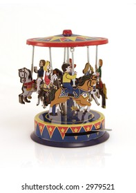 Antique tin toy of a merry-go-round