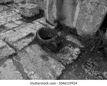 Antique toilet in Gerasa ancient city in black and white