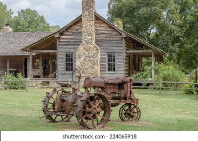 Antique Tractor with Log Cabin background