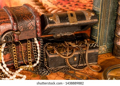 Antique treasure chest with gold and books. Vintage style. 1565 old map of the year.