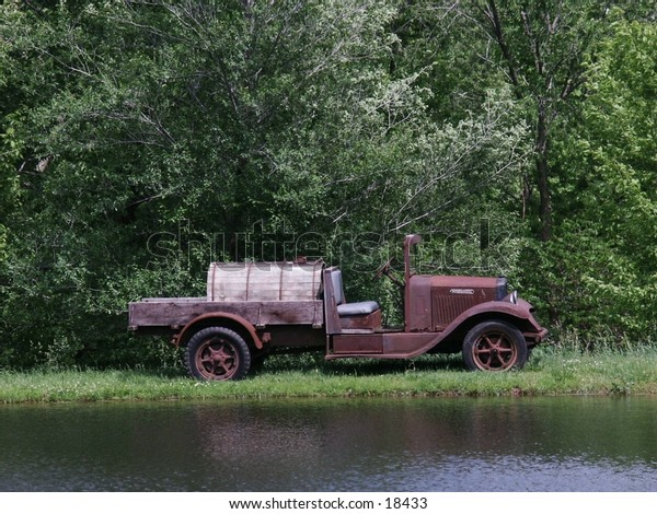 antique truck by a lake