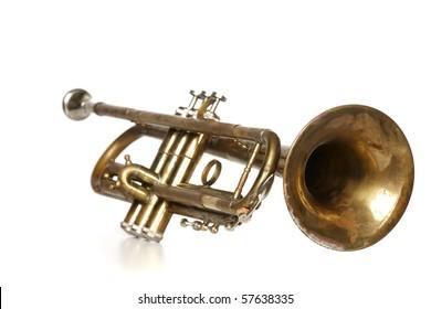 Antique trumpet on white background