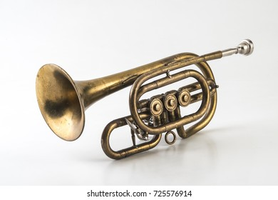 Antique trumpet on white background.