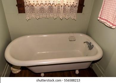 Antique tub in historic bathroom. Old tub.