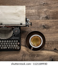 Antique typewriter with grungy textured paper page and coffee