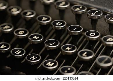 Antique typewriter keys. Detail shot of keys on an old typewriter. Shallow DOF.