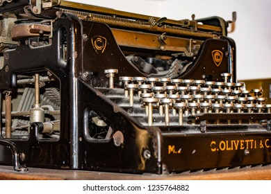 Antique typewriter, model Olivetti Ivrea M20 - 1920 - Detail of the keys and the mechanical parts. Ancient and warm colors.