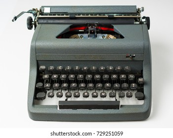 Antique Typewriter on White Background in Perspective
