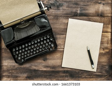 Antique typewriter with paper note book. Creativity concept
