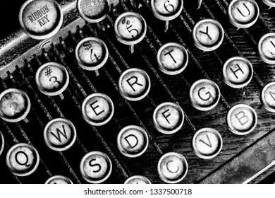 An Antique Typewriter Showing Traditional QWERTY Keys