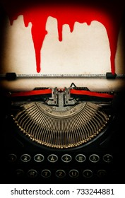 Antique typewriter and used textured paper sheet with blood. Halloween concept. Dark toned picture