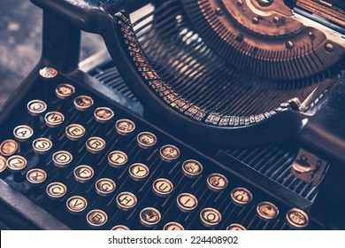 Antique Typewriter. Vintage Typewriter Machine Closeup Photo.