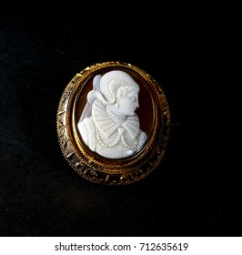 Antique Victorian brooch cameo brown with white face on a black background