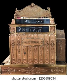 Antique vintage cash register on a black background
