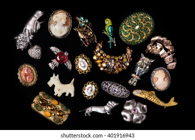 Antique vintage jewelry collection on black background