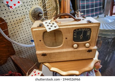 Antique vintage radio in a display of old collectibles for sale Shallow focus on the front of the radio