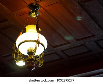 antique vintage retro style decorative glass and metal ceiling lamp installed as lighting and decorative ornament selective focus blur background