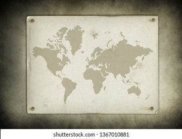 Antique vintage world map parchment nailed to a wall