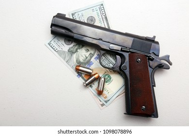 Antique Vintage World War Two .45 Caliber Pistol on Money with Hollow Point Bullets. Isolated on white. Room for text.