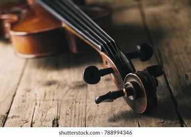 Antique Violin on a wooden floor