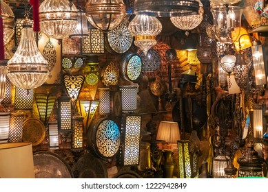 Antique wall lamps with some more colorful Turkish Ottoman lanterns in the Grand Bazaar of Istanbul.