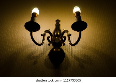 antique wall light in the the dark room in selective focus