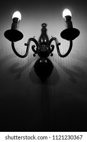 antique wall light in the the dark room in black and white and selective focus